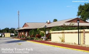 The Holiday Travel Park office, activity center and pool area